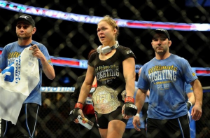 UFC champion Ronda Rousey holding a can of Xyience in the ring after a bout in California.